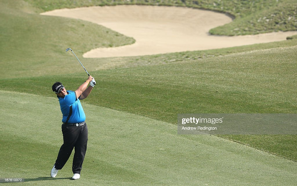 <a gi-track='captionPersonalityLinkClicked' href=/galleries/search?phrase=Kiradech+Aphibarnrat&family=editorial&specificpeople=6827713 ng-click='$event.stopPropagation()'>Kiradech Aphibarnrat</a> of Thailand in action during the completion of the second round of the Ballantine's Championship at Blackstone Golf Club on April 27, 2013 in Icheon, South Korea.