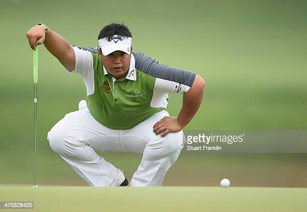 Kiradech Aphibarnrat of Thailand lines up a putt during the final round of the Shenzhen International at Genzon Golf Club on April 19 2015 in...
