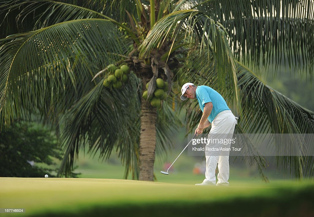 Kiradech Aphibarnrat of Thailand plays a shot during round one of the Thailand Golf Championship at Amata Spring Country Club on December 6, 2012 in Bangkok, Thailand.