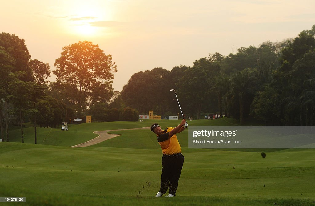 <a gi-track='captionPersonalityLinkClicked' href=/galleries/search?phrase=Kiradech+Aphibarnrat&family=editorial&specificpeople=6827713 ng-click='$event.stopPropagation()'>Kiradech Aphibarnrat</a> of Thailand plays a shot during round two of the Maybank Malaysian Open at Kuala Lumpur Golf & Country Club on March 22, 2013 in Kuala Lumpur, Malaysia.