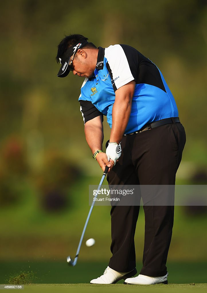 <a gi-track='captionPersonalityLinkClicked' href=/galleries/search?phrase=Kiradech+Aphibarnrat&family=editorial&specificpeople=6827713 ng-click='$event.stopPropagation()'>Kiradech Aphibarnrat</a> of Thailand plays a shot during the first round of the Shenzhen International at Genzon Golf Club on April 16, 2015 in Shenzhen, China.