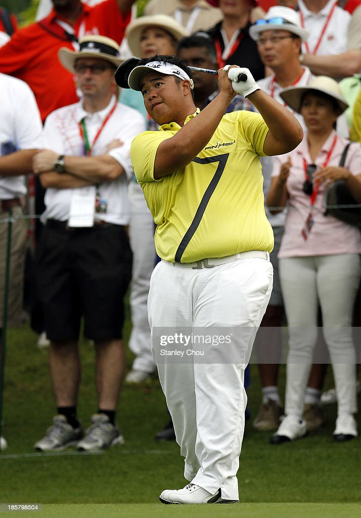 Kiradech Aphibarnrat of Thailand plays his tee shot on the 1st hole during round two of the CIMB Classic at Kuala Lumpur Golf & Country Club on October 25, 2013 in Kuala Lumpur, Malaysia.