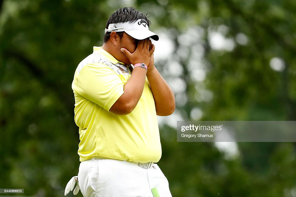 <a gi-track='captionPersonalityLinkClicked' href=/galleries/search?phrase=Kiradech+Aphibarnrat&family=editorial&specificpeople=6827713 ng-click='$event.stopPropagation()'>Kiradech Aphibarnrat</a> of Thailand reacts after a shot on the fourth green during the second round of the World Golf Championships - Bridgestone Invitational at Firestone Country Club South Course on July 1, 2016 in Akron, Ohio.