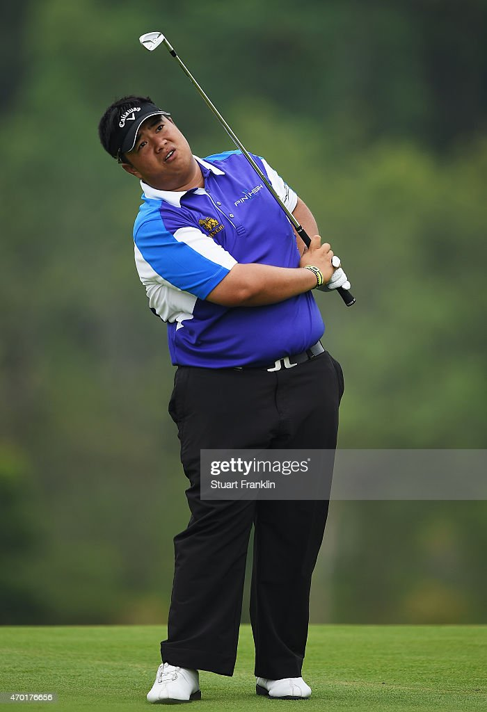 <a gi-track='captionPersonalityLinkClicked' href=/galleries/search?phrase=Kiradech+Aphibarnrat&family=editorial&specificpeople=6827713 ng-click='$event.stopPropagation()'>Kiradech Aphibarnrat</a> of Thailand reacts to a shot during the third round of the Shenzhen International at Genzon Golf Club on April 18, 2015 in Shenzhen, China.
