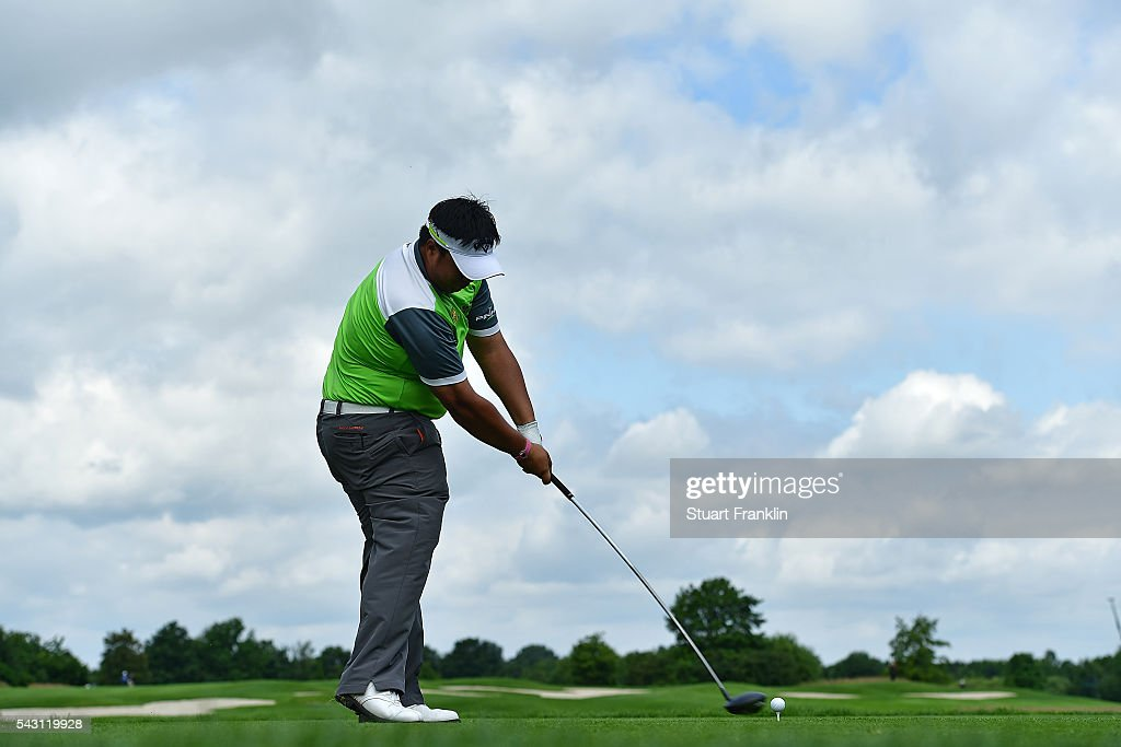 <a gi-track='captionPersonalityLinkClicked' href=/galleries/search?phrase=Kiradech+Aphibarnrat&family=editorial&specificpeople=6827713 ng-click='$event.stopPropagation()'>Kiradech Aphibarnrat</a> of Thailand tees off during the rain delayed third round of the BMW International Open at Gut Larchenhof on June 26, 2016 in Cologne, Germany.
