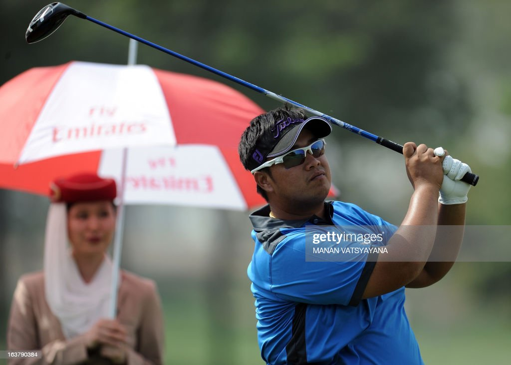 Kiradech Aphibarnrat of Thailand tees off on the eighteenth green during the Avantha Masters golf tournament in Greater Noida, on the outskirts of New Delhi, on March 16, 2013.