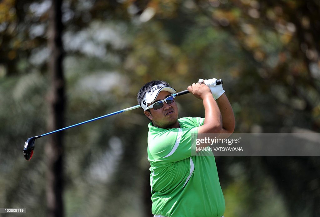 Kiradech Aphibarnrat of Thailand tees off on the fifth hole during the final day of the Avantha Masters golf tournament in Greater Noida on the...