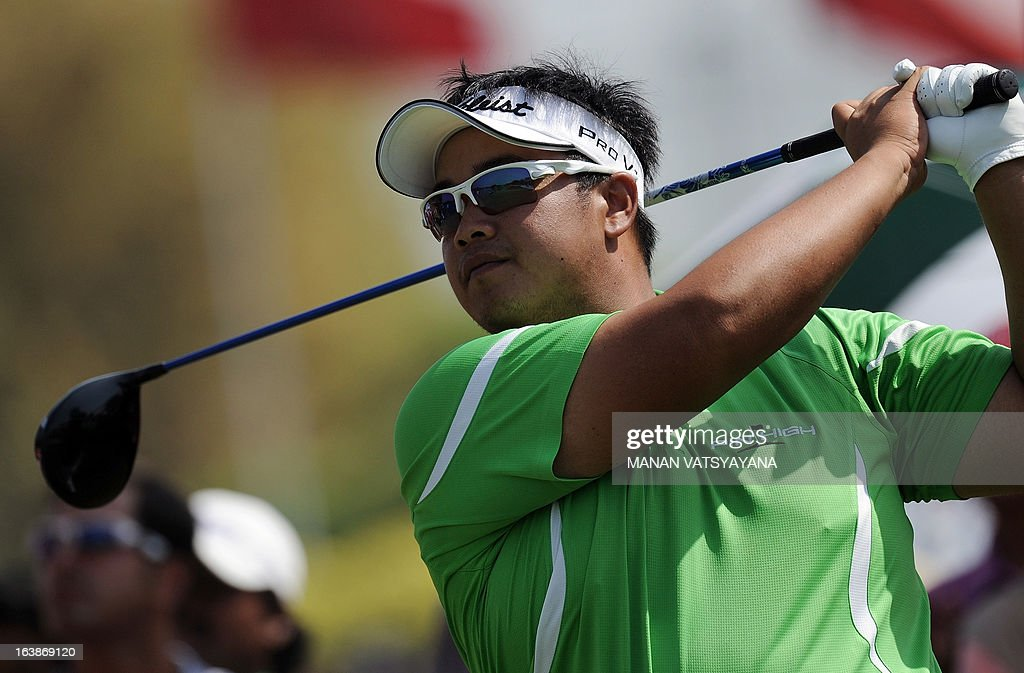 Kiradech Aphibarnrat of Thailand tees off on the first hole during the final day of the Avantha Masters golf tournament in Greater Noida, on the outskirts of New Delhi on March 17, 2013. AFP PHOTO/ MANAN VATSYAYANA