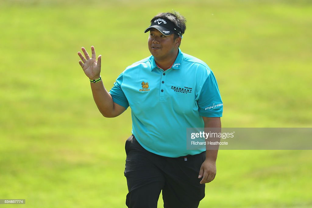 <a gi-track='captionPersonalityLinkClicked' href=/galleries/search?phrase=Kiradech+Aphibarnrat&family=editorial&specificpeople=6827713 ng-click='$event.stopPropagation()'>Kiradech Aphibarnrat</a> of Thailand waves to the crowd during day three of the BMW PGA Championship at Wentworth on May 28, 2016 in Virginia Water, England.
