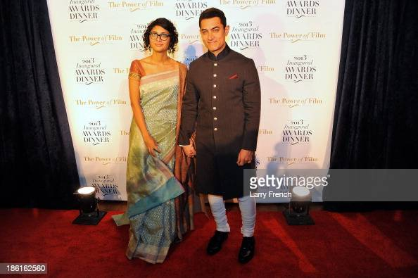 Kiran Rao left and Aamir Kahn attend the 2013 America Abroad Media Awards Dinner at Andrew W Mellon Auditorium on October 28 2013 in Washington DC