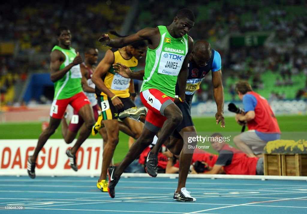 <a gi-track='captionPersonalityLinkClicked' href=/galleries/search?phrase=Kirani+James&family=editorial&specificpeople=5432961 ng-click='$event.stopPropagation()'>Kirani James</a> of Grenada crosses the finish line ahead of <a gi-track='captionPersonalityLinkClicked' href=/galleries/search?phrase=LaShawn+Merritt&family=editorial&specificpeople=546556 ng-click='$event.stopPropagation()'>LaShawn Merritt</a> (R) of United States in the men's 400 metres final during day four of the 13th IAAF World Athletics Championships at the Daegu Stadium on August 30, 2011 in Daegu, South Korea.
