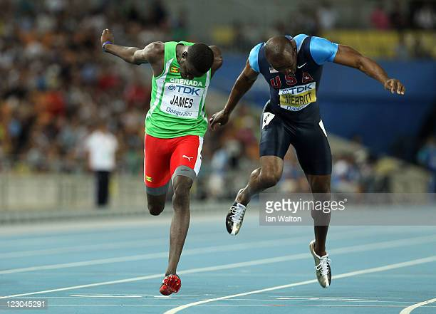 Kirani James of Grenada crosses the finish line ahead of LaShawn Merritt of United States in the men's 400 metres final during day four of the 13th...