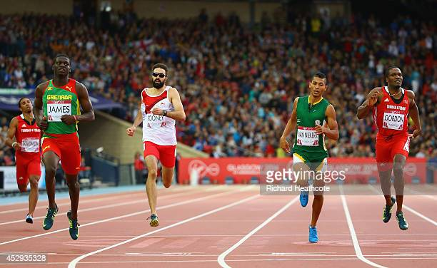 Kirani James of Grenada crosses the line to win gold ahead of Martyn Rooney of England Wayde van Niekerk of South Africa and Lalonde Gordon of...