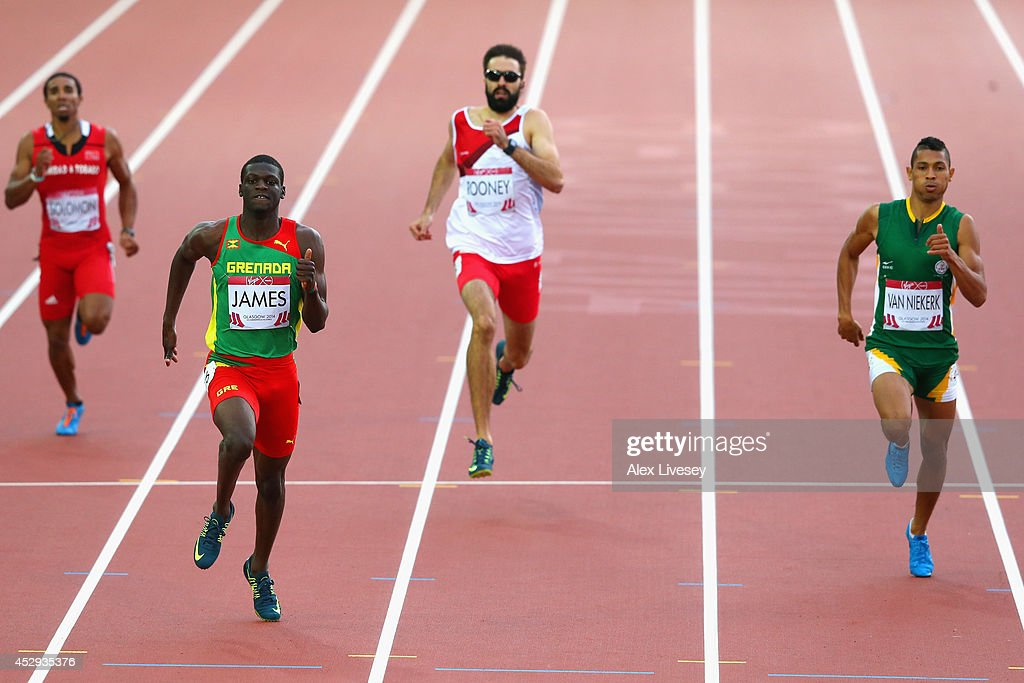 <a gi-track='captionPersonalityLinkClicked' href=/galleries/search?phrase=Kirani+James&family=editorial&specificpeople=5432961 ng-click='$event.stopPropagation()'>Kirani James</a> of Grenada crosses the line to win gold ahead of <a gi-track='captionPersonalityLinkClicked' href=/galleries/search?phrase=Martyn+Rooney&family=editorial&specificpeople=703546 ng-click='$event.stopPropagation()'>Martyn Rooney</a> of England and Wayde van Niekerk of South Africa in the Men's 400 metres Final at Hampden Park during day seven of the Glasgow 2014 Commonwealth Games on July 30, 2014 in Glasgow, United Kingdom.