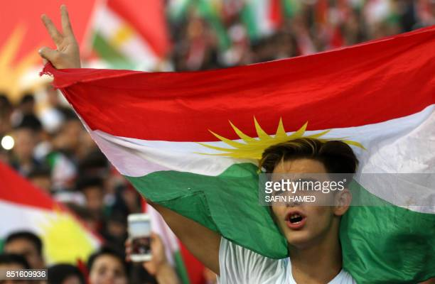 Iraqi Kurds fly Kurdish flags during an event to urge people to vote in the upcoming independence referendum in Arbil the capital of the autonomous...