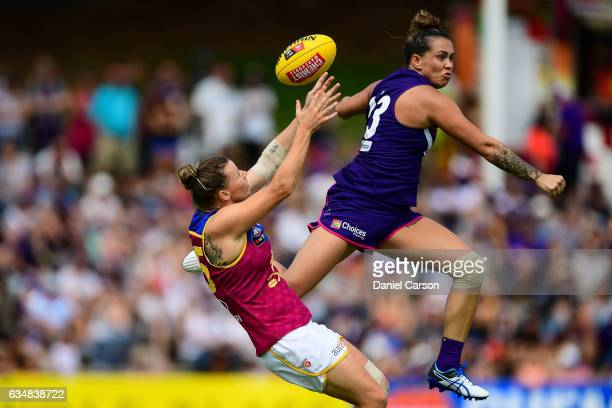 Kirby Bentley of the Dockers misses a spoil attempt on a mark by Brittany Gibson of the Lions during the 2017 AFLW Round 02 match between the...