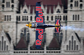 Kirby Chambliss of the Team Chambliss with his Edge 540 V3 plane competes during the Red Bull Air Race World Championship over the river Danube in...