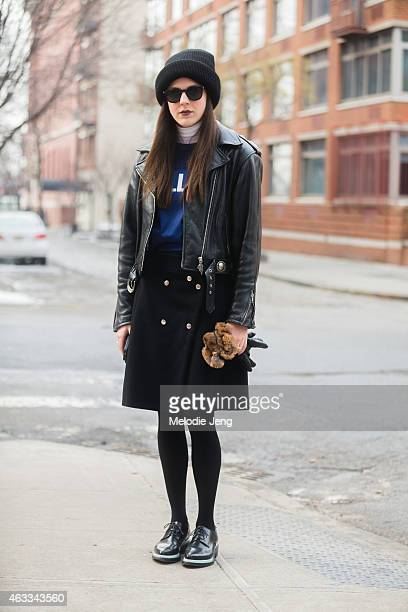 Kirby Marzec of Teen Vogue wears An Elder Statesman hat vintage leather jacket Acne Studios top bag skirt and shoes and Selima sunglasses at Streets...