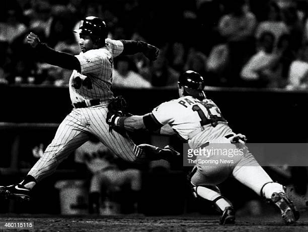 Kirby Puckett of the Minnesota Twins attempts to score against catcher Lance Parrish of the Angels circa 1990