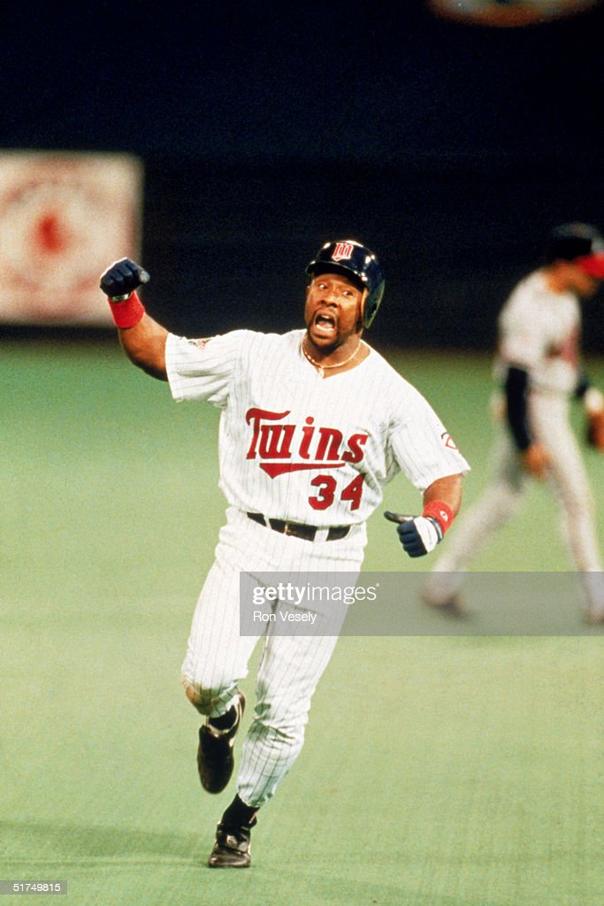 Kirby Puckett #34 of the Minnesota Twins celebrates as he rounds the bases after hitting the game winning home run in the eleven inning of the 1991 World Series against the Atlanta Braves at The Metrodome on October 26, 1991 in Minneapolis, Minnesota. The Twins won 4-3 and tie the series 3-3.