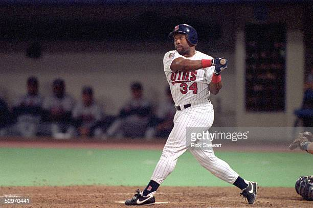 Kirby Puckett of the Minnesota Twins swings at a pitch during Game seven of the 1991 World Series against the Atlanta Braves at the Metrodome on...