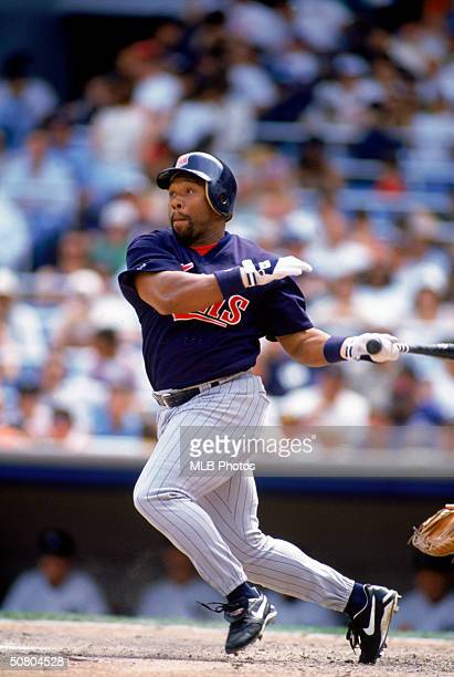 Kirby Puckett of the Minnesota Twins watches the flight of the ball as he heads to first base during a 1995 season game