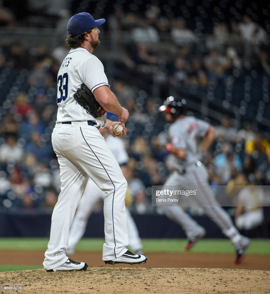 Kirby Yates #39 of the San Diego Padres stands on the mound as Ryan Zimmerman #11 of the Washington Nationals rounds the bases after hitting a solo home run during the eighth inning of a baseball game at PETCO Park on August 17, 2017 in San Diego, California.