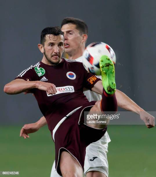 Kire Ristevski of Vasas FC controls the ball in front of Benjamin Balazs of Ujpest FC during the Hungarian Cup Round of 8 second leg match between...