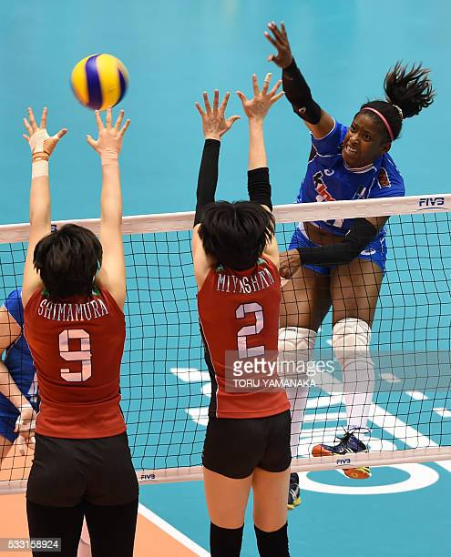 Kiriam Fatime Sylla spikes the ball over Haruyo Shimamura and Haruka Miyashita of Japan Italy during the women's volleyball world final qualification...