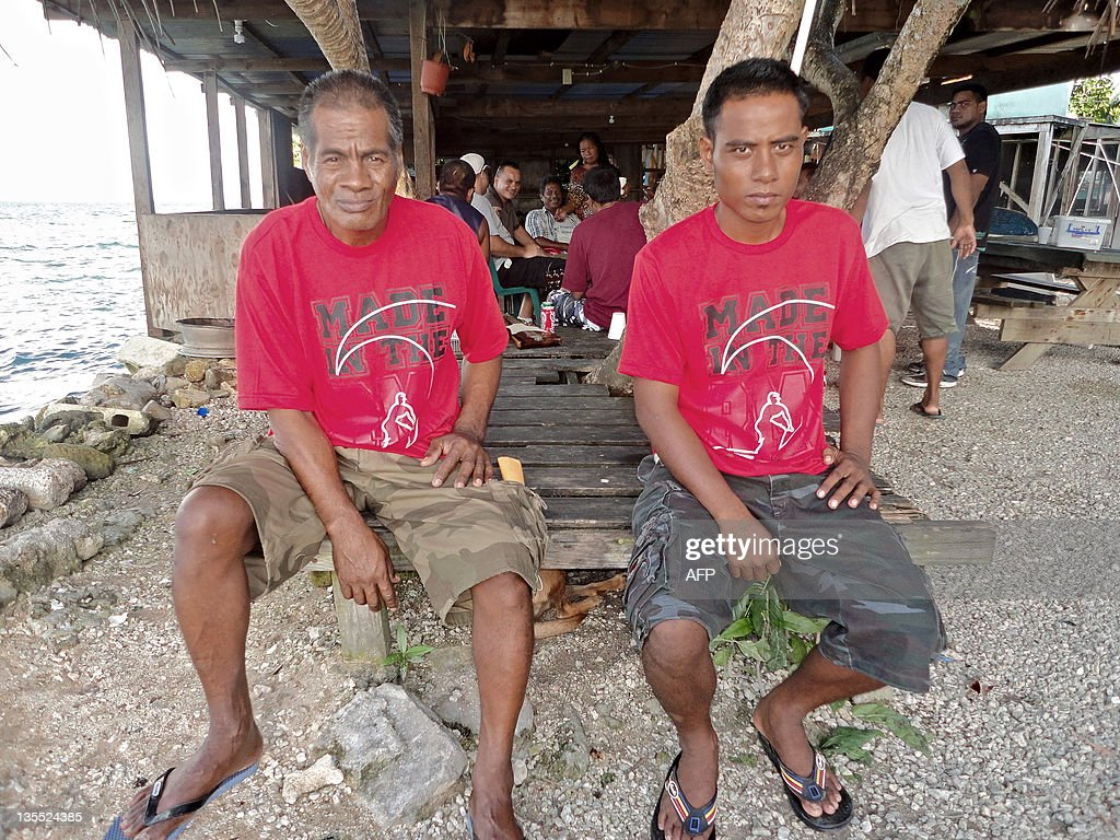 Kiribati fishermen Uein Buranibwe (L), 53, and Temaei Tontaake, 26, who survived a 33-day drift on the ocean sit together after they arrived in Majuro on December 11, 2011. The two Kiribati fishermen recounted their struggle for survival while drifting for 33 days in the Pacific before being washed ashore on a remote atoll and solving a 50-year family mystery.