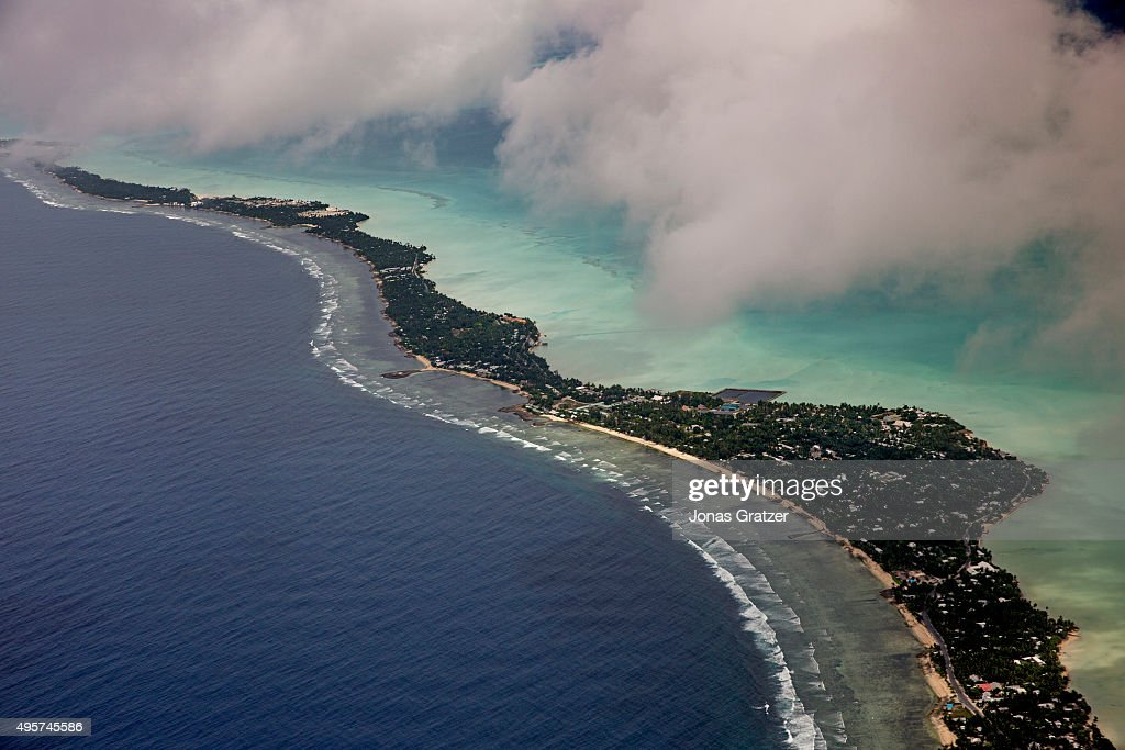 Kiribati Geography from the air a narrow strip of land in the middle of the ocean The people of Kiribati are under pressure to relocate due to sea...