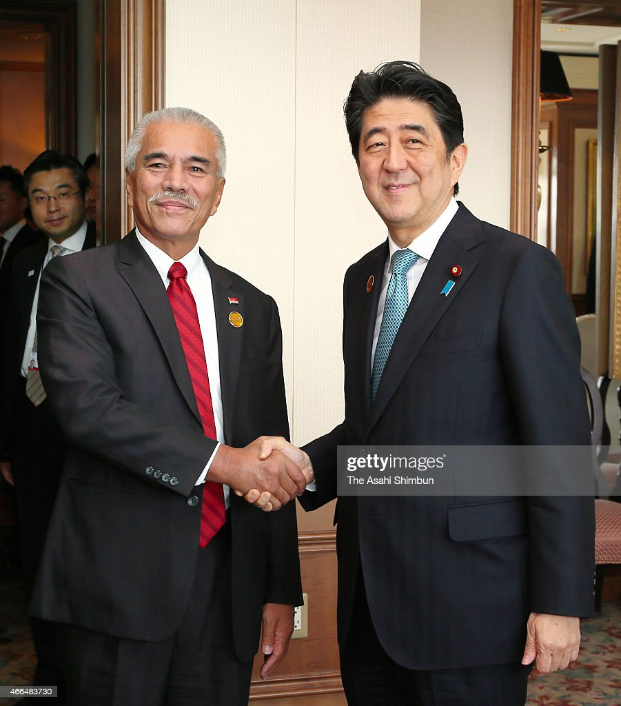 Kiribati President <a gi-track='captionPersonalityLinkClicked' href=/galleries/search?phrase=Anote+Tong&family=editorial&specificpeople=626128 ng-click='$event.stopPropagation()'>Anote Tong</a> (L) and Japanese Prime Minister <a gi-track='captionPersonalityLinkClicked' href=/galleries/search?phrase=Shinzo+Abe&family=editorial&specificpeople=559017 ng-click='$event.stopPropagation()'>Shinzo Abe</a> (R) shake hands prior to their meeting on the sidelines of the U.N. World Conference on Disastere Risk Reduction on March 15, 2015 in Sendai, Miyagi, Japan. More than 40,000 people are expected to take part in the conference, which is being held in the Sendai International Center and other venues through March 18. The participants include government representatives and NGO members from more than 170 countries.