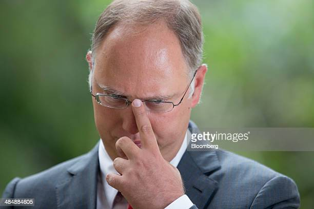 Kiril Dmitriev chief executive officer of Russian Direct Investment Fund reacts during a Bloomberg Television interview at the Boao Forum for Asia in...