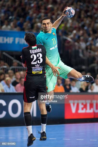 Kiril Lazarov of Barcelona is attacked by Cristian Ugalde of Veszprem during the VELUX EHF FINAL4 3rd place match between Telekom Veszprem and FC...