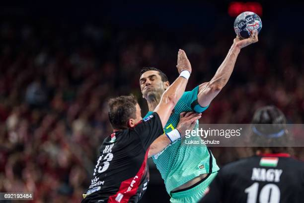 Kiril Lazarov of Barcelona is attacked by Momir Ilic of Veszprem during the VELUX EHF FINAL4 3rd place match between Telekom Veszprem and FC...