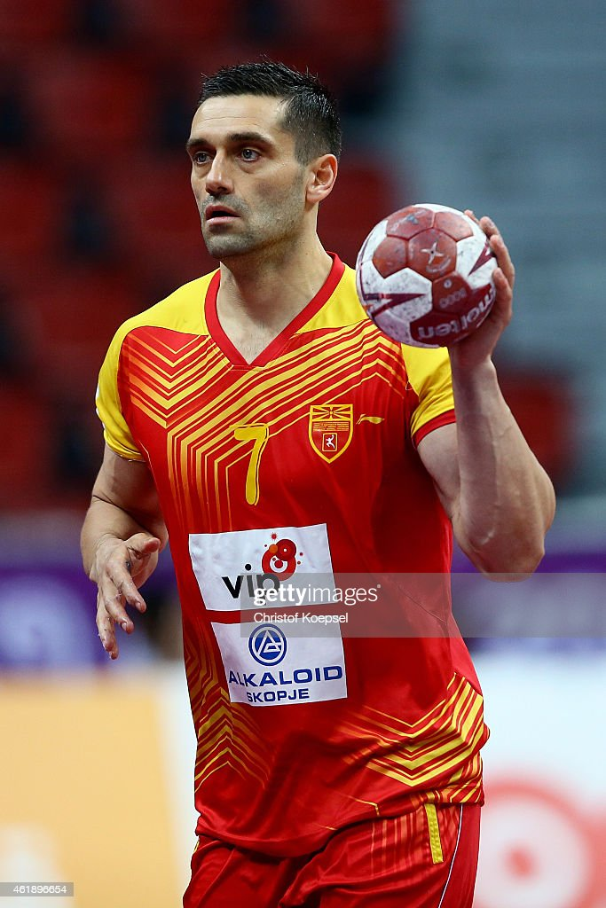<a gi-track='captionPersonalityLinkClicked' href=/galleries/search?phrase=Kiril+Lazarov&family=editorial&specificpeople=3239733 ng-click='$event.stopPropagation()'>Kiril Lazarov</a> of Macedonia passes the ball during the IHF Men's Handball World Championship group B match between Macedonia and Croatia at Duhail Handball Sports Hall on January 21, 2015 in Doha, Qatar.
