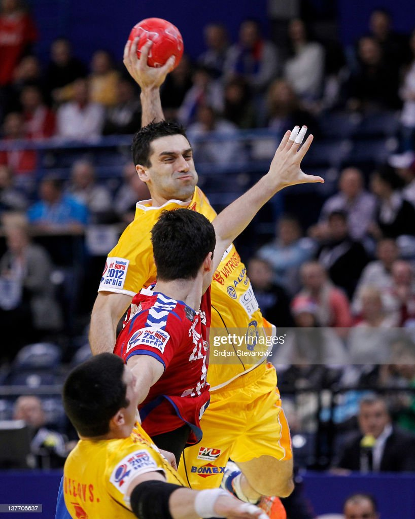 Kiril Lazarov (R) of Macedonia shoots the ball past Petar Nenadic (L) of Serbia during the Men's European Handball Championship 2012 second round group one match between Serbia and Macedonia at Arena Hall on January 25, 2012 in Belgrade, Serbia.