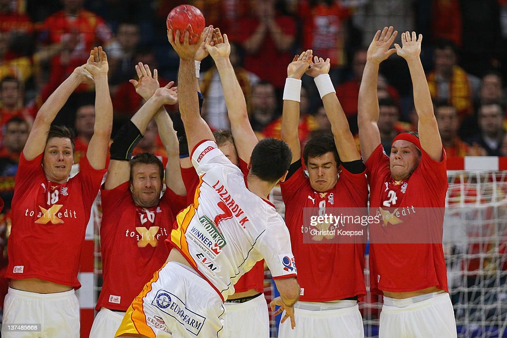 <a gi-track='captionPersonalityLinkClicked' href=/galleries/search?phrase=Kiril+Lazarov&family=editorial&specificpeople=3239733 ng-click='$event.stopPropagation()'>Kiril Lazarov</a> of Macedonia throws against the wall of Denmark during the Men's European Handball Championship second round group one match between Denmark and Macedonia at Beogradska Arena on January 21, 2012 in Belgrade, Serbia.