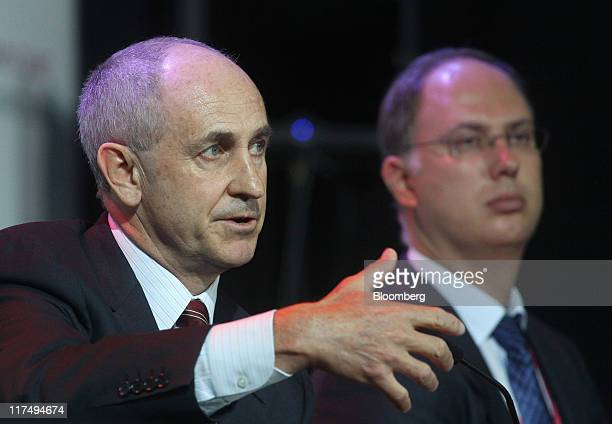 Kirill Dmitriev chief executive officer of Russia Direct Investment Fund right listens while Chris Liddell former chief financial officer of General...