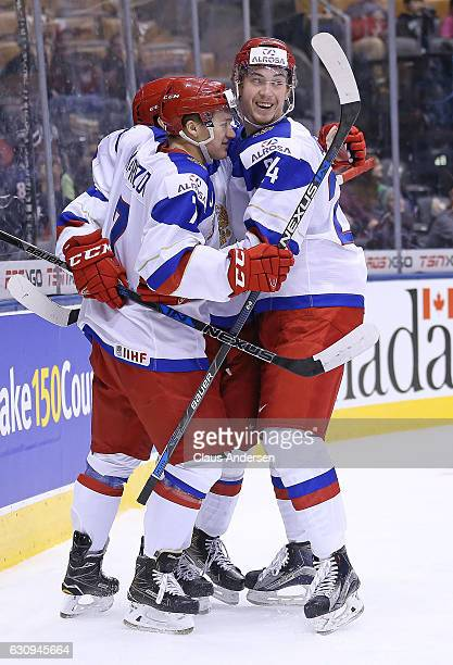 Kirill Kaprizov of Team Russia celebrates a goal with teammate Mikhail Vorobyov against Team Denmark during a QuarterFinal game at the 2017 IIHF...