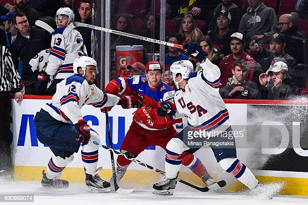 Kirill Kaprizov of Team Russia gets caught between Jordan Greenway and Casey Fitzgerald of Team United States during the 2017 IIHF World Junior...