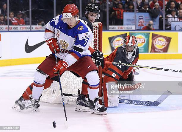Kirill Kaprizov of Team Russia looks to spin and get a shot at Carter Hart of Team Canada during a game at the the 2017 IIHF World Junior Hockey...