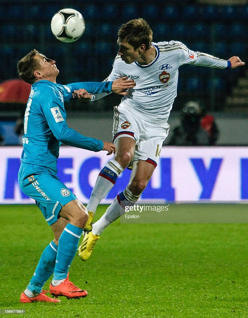 Kirill Nababkin of PFC CSKA Moscow (R) and <a gi-track='captionPersonalityLinkClicked' href=/galleries/search?phrase=Vladimir+Bystrov&family=editorial&specificpeople=2056444 ng-click='$event.stopPropagation()'>Vladimir Bystrov</a> of FC Zenit St. Petersburg vie for the ball during the Russian Football League Championship match between FC Zenit St. Petersburg and PFC CSKA Moscow at the Petrovsky Stadium on November 26, 2012 in St. Petersburg, Russia.