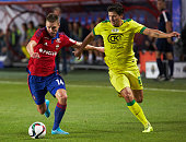 Kirill Nababkin of PFC CSKA Moscow challenged by Ilya Maksimov of FC Anzhi Makhachkala during the Russian Premier League match between PFC CSKA...
