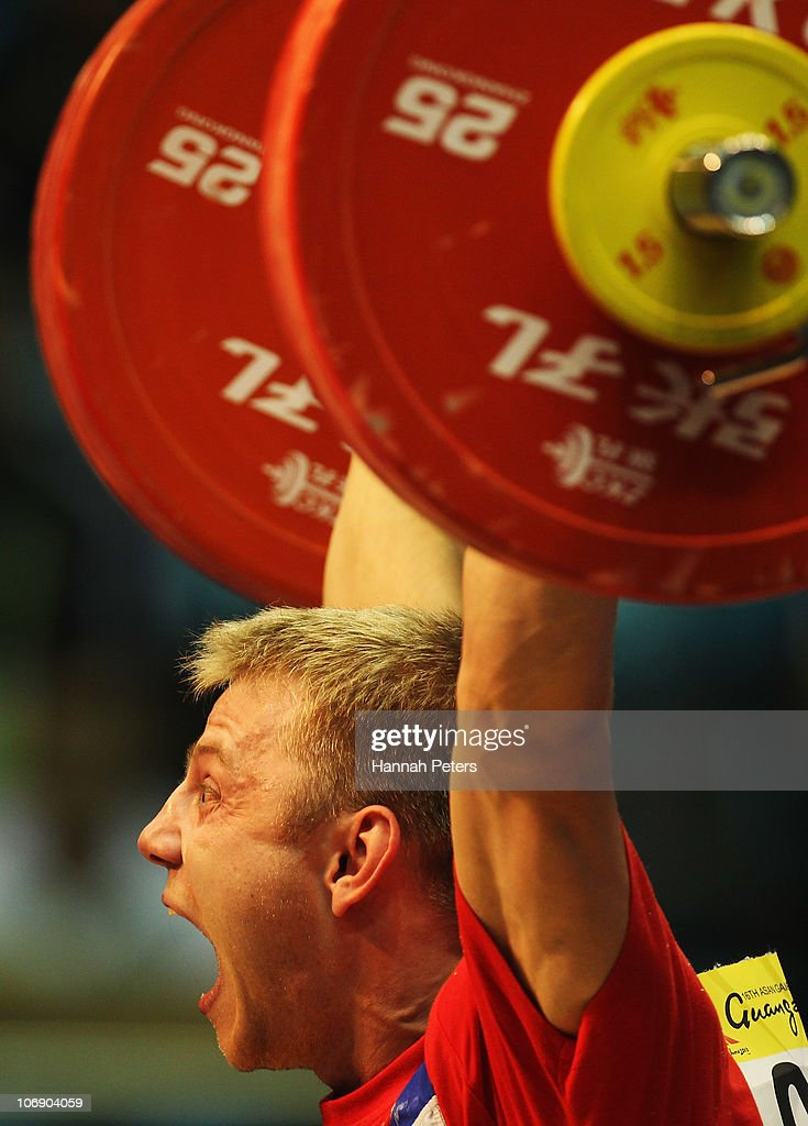 Kirill Pavlov of Kazakhstan competes in the Men's Weightlifting 77kg competition during day four of the 16th Asian Games Guangzhou 2010 at Dongguan Gymnasium on November 16, 2010 in Guangzhou, China.