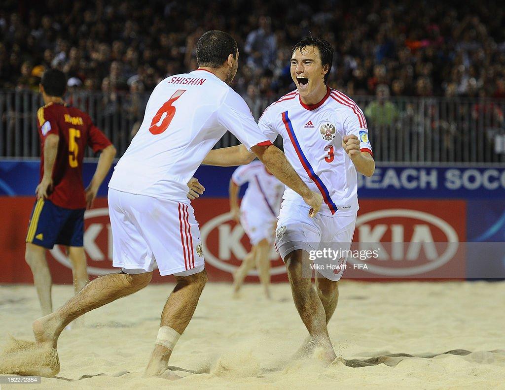 Kirill Romanov of Russia celebrates with Dmitrii Shishin after scoring during the FIFA Beach Soccer World Cup Tahiti 2013 Final between Spain and Russiai at the Tahua To'ata Stadium on September 28, 2013 in Papeete, French Polynesia.