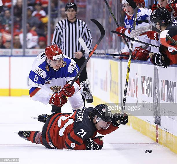 Kirill Urakov of Team Russia battles against Blake Speers of Team Canada during a game at the the 2017 IIHF World Junior Hockey Championships at the...