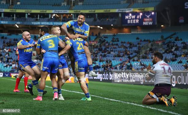 Kirisome Auva'a of the Eels celebrates scoring a try with team mates during the round 21 NRL match between the Parramatta Eels and the Brisbane...