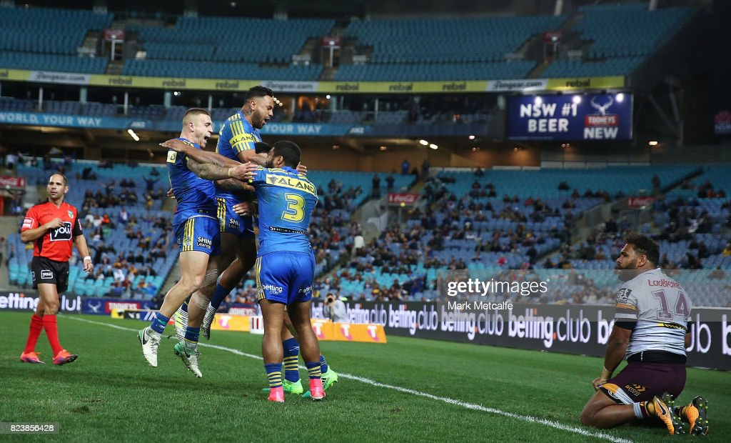 Kirisome Auva'a of the Eels celebrates scoring a try with team mates during the round 21 NRL match between the Parramatta Eels and the Brisbane Broncos at ANZ Stadium on July 28, 2017 in Sydney, Australia.