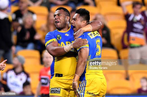 Kirisome Auva'a of the Eels is congratulated by team mates after scoring a try during the round 25 NRL match between the Brisbane Broncos and the...